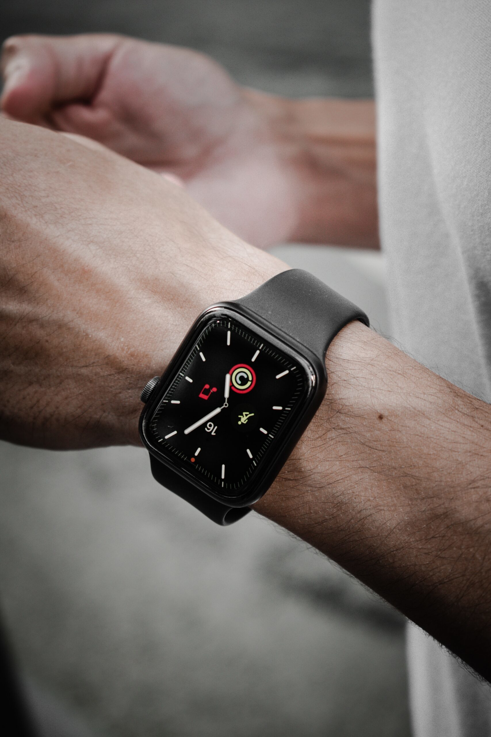 black and silver aluminum case apple watch with black sport band